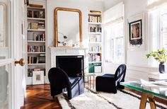 Love this look. living room fireplace mirror books bookcase