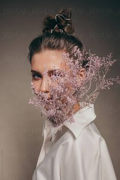 Woman with pink fragile flowers growing from her shirt by Liliya Rodnikova - Stocksy United. Creative Portrait Photography, Concept Photography, Photography Editing, Creative Portraits, Creative Photos, Artistic Photography, Fashion Photography, Inspiring Photography, Stunning Photography