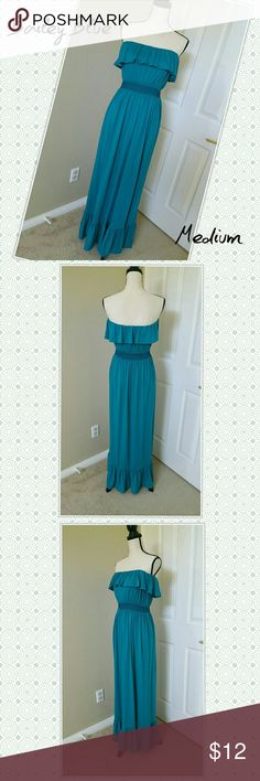 """🏝 Strapless Maxi Dress Sundress Bailey Blue * Strapless maxi dress by BaileyBlue. Teal blue-green color. Ruffled top and bottom. Elastic above bust and at waist keeps it in place. * Medium, equivalent to a size 8 (IMO).  * 51"""" length, stretches to 34"""" bust and 30"""" waist. * 68% polyester, 28% rayon, 4% spandex * Good used condition. Some pilling on fabric.  I 💙 OFFERS • BUNDLE & SAVE • FAST SHIPPER 🚀 Bailey Blue Dresses Maxi"""
