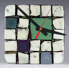 French vanilla squares are interspersed with colorful translucent squares & shards, sprinkled with black frit to create a rich contemporary patchwork of color in this fused clock