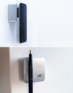 """JustMount is a magnetic wall mount organizer will get clutter like your keys, iPhone, and earbuds up off your workspace and keep them easily within reach. And speaking of reach, another use for the device is the convenience of """"hands-free"""" video calls, popular with couples in long distance relationships. $19.00"""