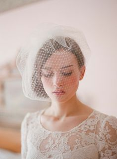 With the cutest and most face flattering shape, this modern birdcage veil sheer bliss    handmade with russian veiling and tulle  handsewn to a gold plated wire comb  available in ivory (as pictured) or white  Unsure of the color? Purchase a tulle swatch HERE      Lovely dress by Leanne Marshall: http://leanimal.etsy.com