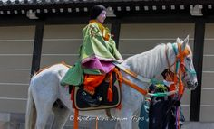 In the Aoi Matsuri (葵祭) held annually in the Old Heian Capital of Japan, Kyoto, ladies dressed in the ceremonial robes of the ancient Heian Court participate on horseback.