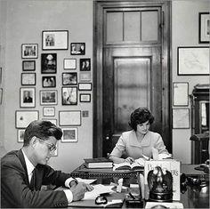 President John Kennedy and Jackie at desks, July 1, 1962