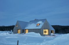 The three volumes house the three wings of the home: a communal area with a kitchen, dining, and living area; a master suite; and a guest suite. #dwell #moderncabins #canada #quebec