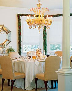 At Martha's East Hampton, New York, home on Lily Pond Lane, she sets a simple elegant holiday table decorated in soft pinks and silvers rather than red and green.