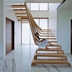 Elegant Staircase For Modern Home Interior Design Ideas: Cool Spinal Staircase Design Wooden Material Stand On Marble Floor ~ justsoakit.com Interior design Inspiration