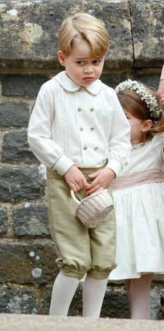 Prince George unhappy after a scolding from mum after the marriage of Pippa Middleton and James Matthews. May 20 2017.