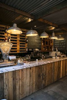 """love the lighting and reclaimed lumber with marble top for bar ideas Vintage ambiance in restaurant """"O Prego na Peixaria"""", Escola politécnica Lisboa. Rustic Coffee Shop, Coffee Shop Design, Wine Bar Design, Coffee Cafe, Rustic Cafe, Egg Coffee, Rustic Wood, Coffee Shop Bar, Coffee Shops"""