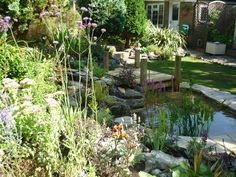 Small Garden Pond Design Water features add a peaceful sound to any yard or garden