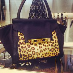 Loving the new leopard print trapezoid bag! shop at Sears and Sears.com/Kardashian
