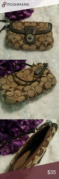 Coach wristlet Brown authentic coach wristlet. About 7 inches long and 5 inches tall. Zipper top and twist turn pocket on front. Excellent condition Coach Bags Clutches & Wristlets
