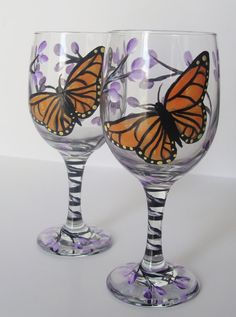 Hello, I have hand painted and designed this beautiful Monarch Butterfly and Lilacs set of two wine glasses. I have painted a butterfly and lilacs on one side and just lilacs on the other with a great amount of detail. The lilac tree winds down the stem of the glass and ends in a small cluster of lilacs on the base. I call this design Beautiful Butterfly it is from my Flutter collection. These wine glasses are perfect to use for serving special guests or treat yourself to using a beautiful…