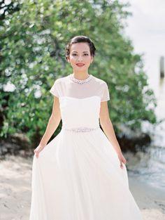 Beaded neck illusion neckline gown: http://www.stylemepretty.com/little-black-book-blog/2015/07/06/romantic-coastal-bridal-inspiration/   Photography: Jacqui Cole - http://jacquicole.com/