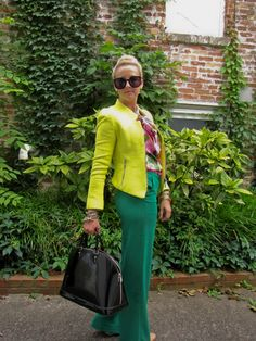 Colored textured collarless blazer + floral secretary blouse + colored full trousers