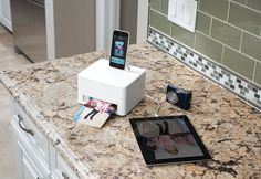 Get your favorite photos off of your smartphone... and onto high-quality paper! The Smartphone Photo Cube Printer from Sharper Image makes amazing color photos, without a computer.