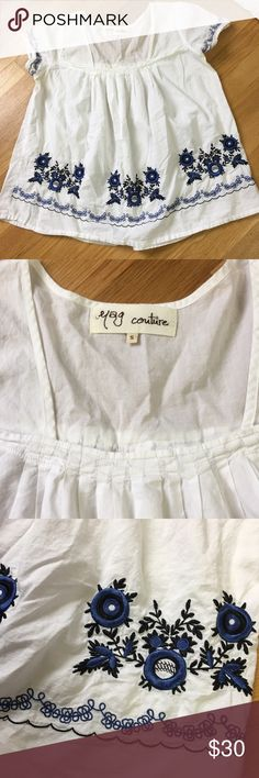 Anthro yag couture floral top Super cute top by yag couture by anthropologie. Size small. Light weight and cool. Perfect for summer. White with blue and black floral stitching. Anthropologie Tops Blouses