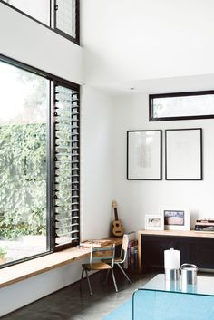 Black joinery with contemporary looking louvres - classic