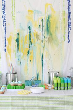 """Splashed paint backdrop with """"oh happy day's"""" dot garland. QUOTE"""" max's messy paint party was a real splash! lots of washable paint and silly string and water balloons being hurled about.   it's not everyday you're allowed to make a big mess...max was in his glory!"""