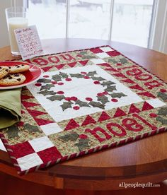 Send out a cheerful holiday greeting with a holly-and-berry table topper.