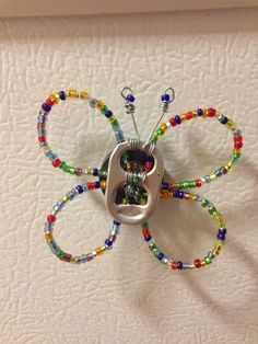 These butterflies are a cool use for pop can tabs! I've been trying to find these beads to make make rafiki bracelets though. Soda Tab Crafts, Can Tab Crafts, Hat Crafts, Bottle Cap Crafts, Jewelry Crafts, Kumihimo Bracelet, Pop Top Crafts, Pop Can Tabs, Soda Can Art
