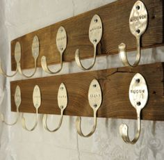 Green-minded designer JJ Evensen has created a unique coat rack using nothing but two wooden planks, screws, and old spoons. Each spoon bears a customized name of the coat's owner. A fantastic example of creative reuse. PSFK » Creative Reuse: 100% Upcycled Coat Rack