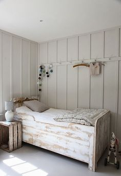 this rustic whitewash bed frame is very cute!