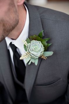 Can we talk about the flowers in this wedding for a sec? They're show stoppers. A beautifully cascading bride's bouquet, rich purples complemented by the prettiest sage greens and vases filled with sw...