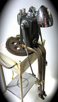 """""""love sick""""  made from a vintage electrical box, table legs, bicycle head lamp, pencil sharpener, windshield wiper arms, doorbell chimes, v8 engine rocker arms, hands made from a vacuum cleaner latch, metal gear, and some other odds and ends."""