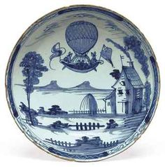 A LONDON DELFT BLUE AND WHITE 'BALLOONING' BOWL CIRCA 1785, LAMBETH Painted with Blanchard's balloon ascending above a rural landscape, with buildings and trees within a diaper-pattern border