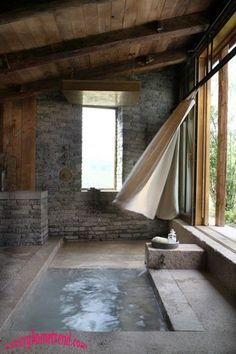 Natural Stone Bathroom, this is the awesomest bathroom ever!!!!  Forget the bathroom part...put in an endless pool!  Awesome!