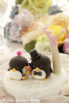 Penguins with flower tree Wedding Cake Topper. $140.00, via Etsy.