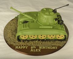 carved tank cake, for any birthday boy into the army and military. carved cake to look like a tank, covered in army green with modelled guns and detailing. Army Birthday Cakes, Themed Birthday Cakes, Birthday Cake Toppers, Themed Cakes, Army Tank Cake, Army Cake, Military Cake, Marine Cake, Novelty Cakes