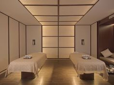Regent Bali's luxurious spa treatment room for couple.