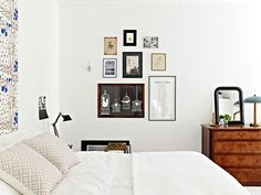 whiteness, dark wood and the perfect wall arrangement