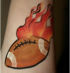 Here, we incorporate the latest tattoo design ideas to make you brilliant football tattoos you've been looking for in years. Face Painting For Boys, Leg Painting, Face Painting Designs, Latest Tattoo Design, Tattoo Designs, Viking Face Paint, Football Face Paint, Football Tattoo, Arm Art