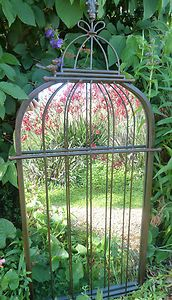 This is sooo pretty! A birdcage mirror.