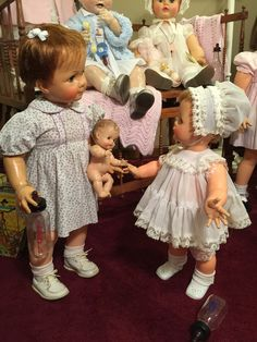 "These are ideals 22"" kissy and 28"" saucy walker sharing a little ""so wee"" rubber squeaky baby by sun rubber co. Both dolls are from the early 60's Toddler Dolls, Baby Dolls, Doll Toys, Porcelain Dolls For Sale, Porcelain Dolls Value, Vinyl Dolls, Barbie, Doll Display, Reborn Dolls"