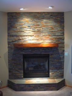 Get inspired with this amazing photo of stack stone fireplaces with colorful rocks. You can't be wrong with it.