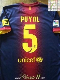 4afcaaaf155 Relive Carles Puyol s La Liga season with this original Nike Barcelona home  football shirt.
