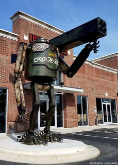 This giant robot stands guard outside Greensboro's Burger Warfare.