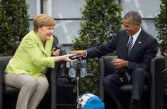 Former U. President Barack Obama, right, and German Chancellor Angela Merkel smile as Obama hands over a headphone for translation during a discussion event on democracy and global responsibility at a Protestant conference in. Obama Vice President, First Black President, Black Presidents, Greatest Presidents, Presidente Obama, Barack Obama Family, Michelle Obama, How To Memorize Things, Stars