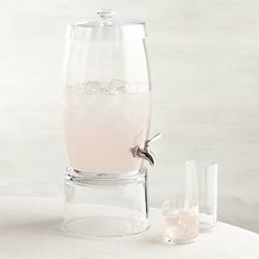 Shop Britta Optic Glass Drink Dispenser. Detailed with the same faceted optics of our Britta Optic barware collection, this sleek glass drink dispenser with spigot delivers more than two gallons of sangria, flavored water or lemonade.