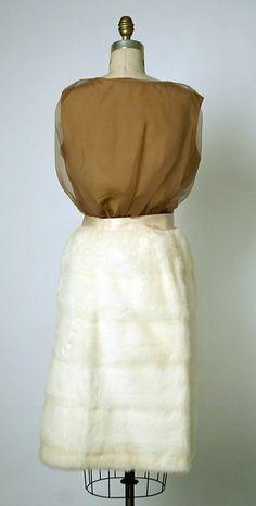 Balenciaga couture evening ensemble from fall/winter 1967-1968. Silk sleeveless top with mink fur skirt, ribbon bow belt and a matching sling bag. Cristobal Balenciaga, House of Balenciaga.
