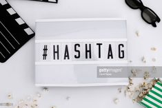 Foto de stock : top view lightbox with hastagh message and movie items Social Media List, Social Media Pages, List Of Hashtags, Trending Hashtags, Business Sales, Create Awareness, Top View, Social Platform, Campaign