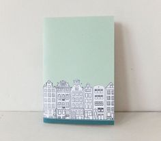 This listing is for a small A6 mint green Amsterdam journal with a fabulous line drawing of the canal houses in Amsterdam, the Netherlands. The
