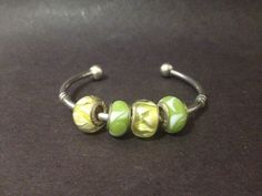 99c START - Pre Owned Bangle w/ 4 x sterling silver charms - Stamped 925