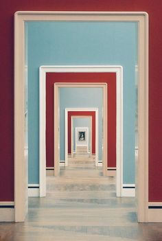 """""""A Thousand Doors"""" by Phillip Klinger. Red and celadon blue enfilade at the Neue Pinakothek: an art museum in Munich, Germany #enfilade #infilata #interiordesign - More wonders at www.francescocatalano.it"""