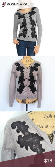 """Cabi Lace Applique Gray & Black Cardigan Small Pretty CAbi gray button up cardigan with black lace appliques on the front. Size small, 100% cotton.  Please note flaw--- on inside of one sleeve there are a few pulls/tiny holes as shown in the last 2 photos. They are barely noticeable when worn (last photo shows sleeve worn over my arm). Priced accordingly.  Same day or next business day shipping. Offers always welcomed & bundles always discounted. """"Like"""" my items for private flash sales! CAbi…"""