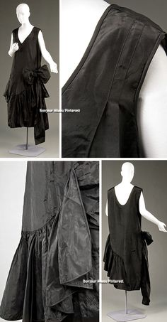 Dress, American, ca. 1928 (or 1920-25?), bought at Bonwit Teller, New York. Black silk moiré (faille) taffeta chemise with two sashes on proper left side that tie to form a large bow. Dropped waist denoted by pairs of vertical darts and gathered hem flounce. Probably a custom creation in Bonwit Teller's dressmaking salon, an adaptation of a couture model (probably by Vionnet). Historic Deerfield